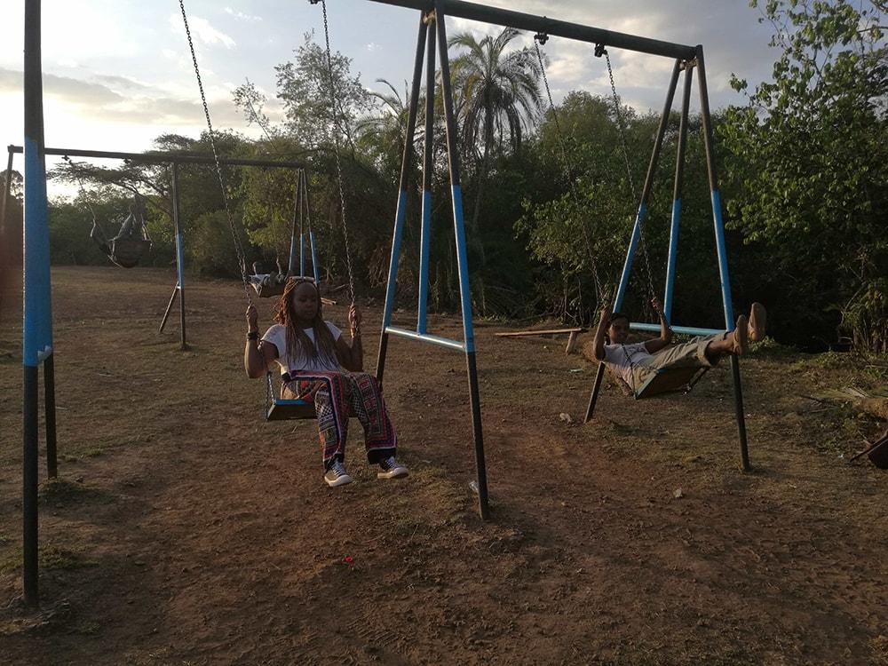 Enjoying the slides at Kitale National Conservancy in Kitale, Kenya