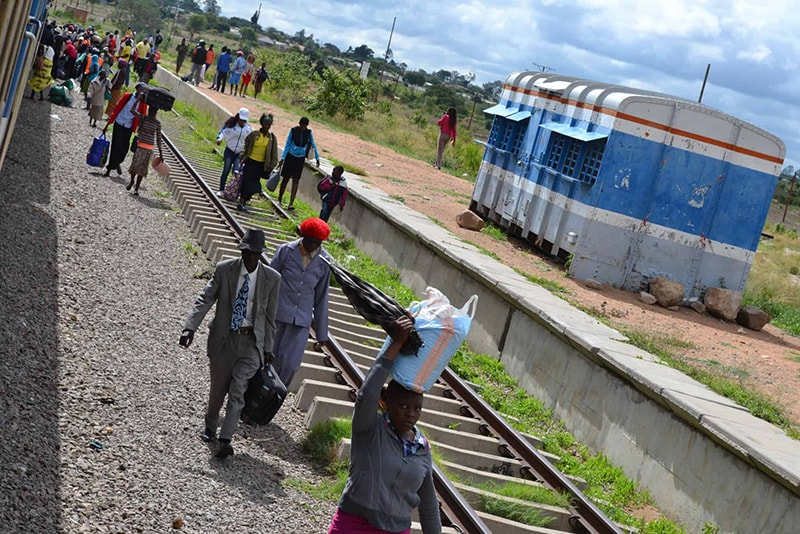 People-disembarking-from-the-train-in-Zimababwe-Wangechi-Gitahi-Travels